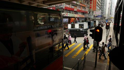 Pedestrian crossing under viaduct, people walk, bus... Stock Video Footage