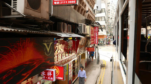 Chinese signboards slide beside, as seen from moving vehicle, second floor Footage