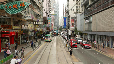 POV ride across city junction, along tram line at... Stock Video Footage