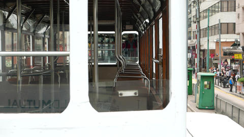 Empty carriage of double decker tram, view through window along seats Footage