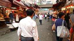 Chinese people walk through Bowrington wet market, Wan Chai Stock Video Footage