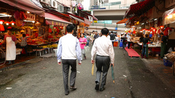 Chinese people walk through Bowrington wet market, Wan Chai Footage