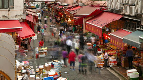 Couple stand still at crowdy street market area, people... Stock Video Footage