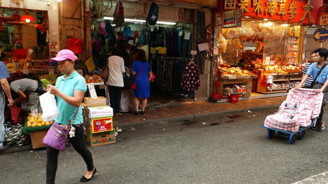 Woman come at street market, loader man push cart along Footage