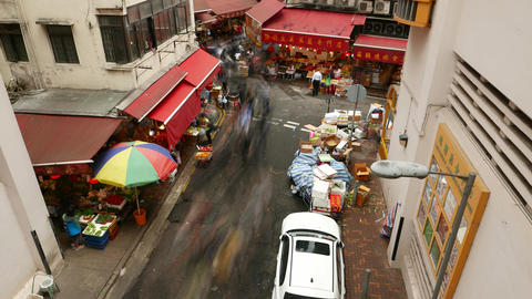 People stream along market street corner, timelapse shot from above Footage