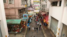 People walk along Wan Chai road, near with Bowrington... Stock Video Footage