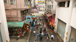 People walk along Wan Chai road, near with Bowrington Road Market Footage