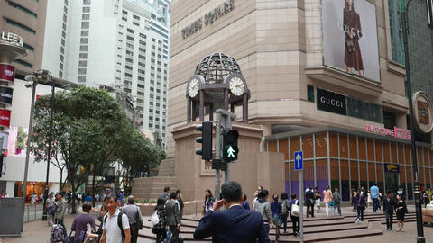 Times square major shopping centre in Hong Kong, tilt up from clock to building Footage