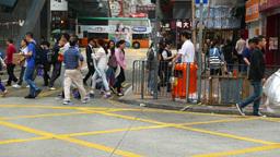 Pedestrian rush across street on green light, fine side... Stock Video Footage