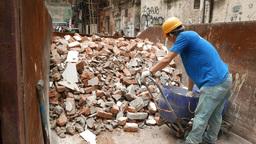 Builder unload construction waste, drop brickbats into trash Stock Video Footage