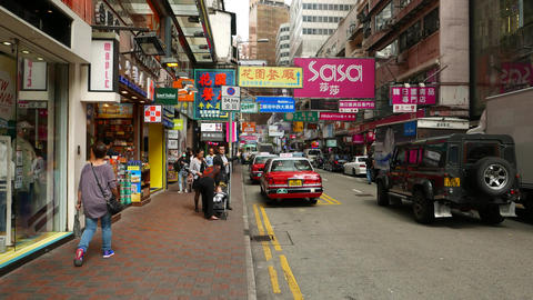Vibrant shopping street at Hong Kong, many signboards shops around Footage