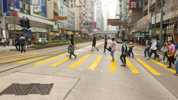 Pedestrian crossing being crowded people walk on green light Footage