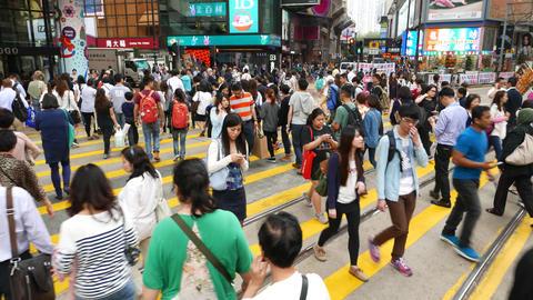 People crowd crossing street by zebra, POV overhead walk... Stock Video Footage