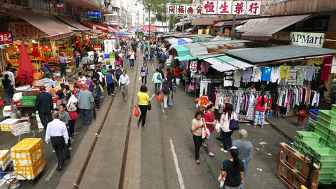 Street market in motion, garments and vegetable stalls, outdoor trade Footage