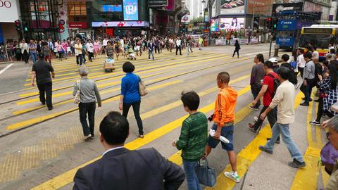 Walk through wide crowded crosswalk, pedestrian spring... Stock Video Footage