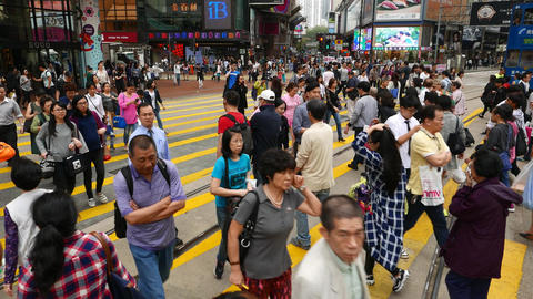 Walk through wide crowded crosswalk, pedestrian spring forward on green light Footage