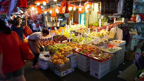 Wide range of fruits on street market stall, chinese... Stock Video Footage