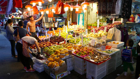 Wide range of fruits on street market stall, chinese price tag plates, bright Footage