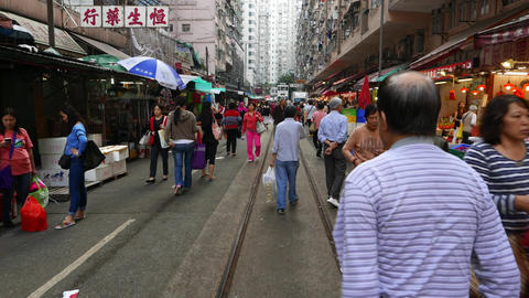 POV walk through street market in Hong Kong, many people... Stock Video Footage