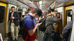 Man receive phone call while travel at metro train, POV camera side view Footage