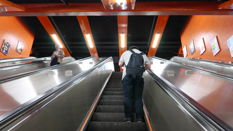 One boy stand at escalator moving up, POV camera looking... Stock Video Footage