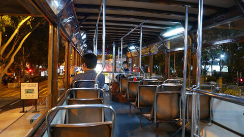 Traditional double decker tram interior, night time, Victoria Park tramway stop Footage