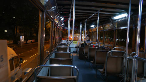 POV ride within old double decker tram at night time, Causeway Bay Footage