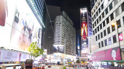 Bright And Glowing Night City Street From Moving Vehicle Look Backward, Tilt Up stock footage