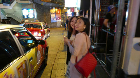 Night city life at D'Aguilar Street, famous Lan Kwai Fong, bars and restaurants Footage