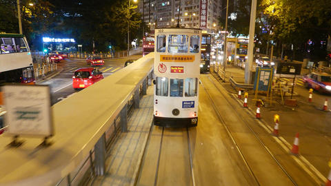 Approaching tram riding ahead, night city road, close up view interior Footage