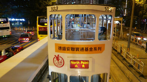 Approaching tram riding ahead, night city road, close up... Stock Video Footage