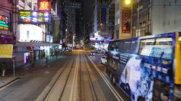 Night city, chinese billboards and signs, double decker bus approach Footage
