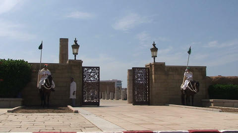 Guards on horses at entrance, Hassan Tower Stock Video Footage
