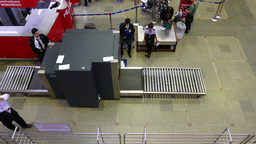Man walk beside X-Ray scanner airport hall, view from above, no luggage Footage
