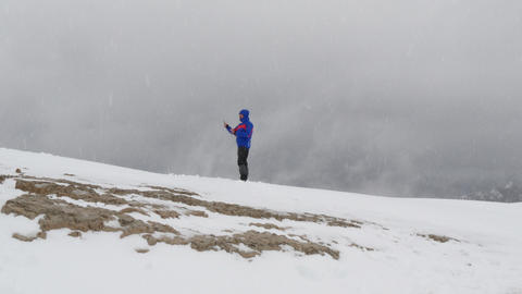 making a selfie on dolomites summit in snow 4k 11764 Stock Video Footage