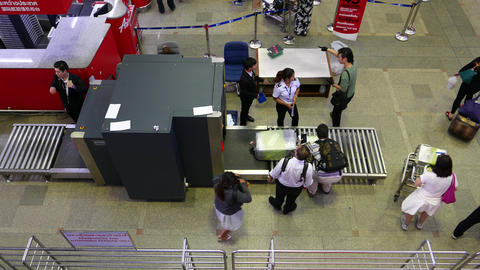 Passenger luggage scanned at X-ray, people entering... Stock Video Footage