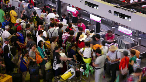 Dense throng mess fuss around check-in counters, registration desks, timelapse Footage