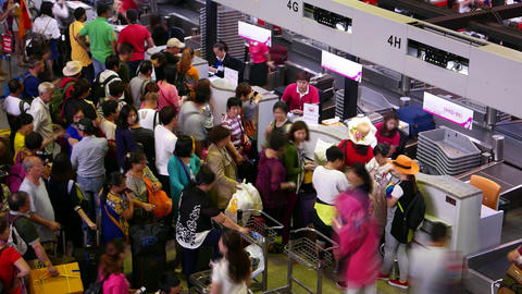Dense throng mess fuss around check-in counters,... Stock Video Footage