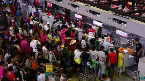 Throng mess against check-in counters, chinese... Stock Video Footage
