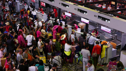 Overcrowded check-in counters, chinese passengers throng around, DMG airport Footage
