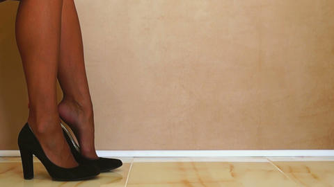 Woman Putting on Black Shoes Stock Video Footage