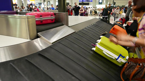 Women slow down hold suitcase slide down from outlet, prevent from damage Footage