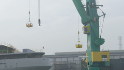 Working shipyard cranes. Heavy industry. Foggy day Footage