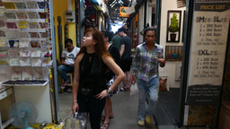 POV walk within market, art paintings, handicraft shops, people shopping, narrow Footage