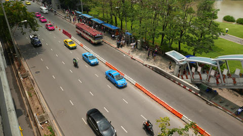 Taxi car queue, bus stop, sparse road traffic, people on sideway, overpass exit Footage