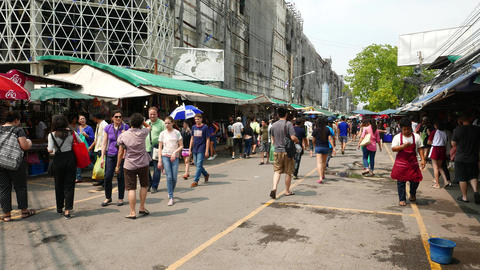 Side alley of Chatuchak market, tourist and visitors stroll around Footage
