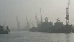 Shipyard, Harbor Cranes And River Covered In Mist stock footage