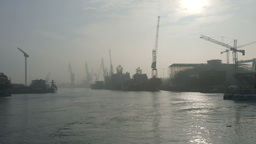 Shipyard, harbor cranes and river covered in mist Footage