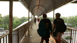 Two boys friends walk through pedestrian overpass, POV follow camera Footage
