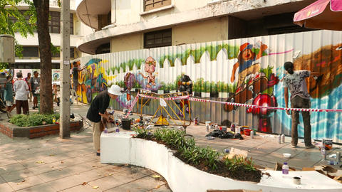 Street art painted on fence, enclosing building to be rebuild Footage
